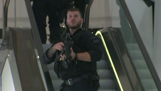 An armed police officer patrols a department store near to Oxford Street in London on Friday night.
