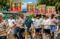 Cricket fans line up to vote in the Queensland election before play begins at the Gabba.
