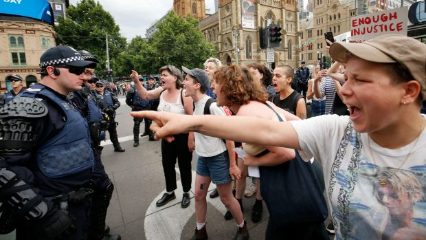 Protesters clash with police on Swanson St in Melbourne's CBD.