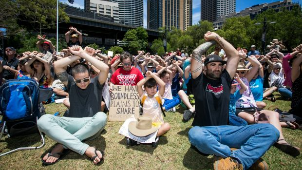 Protesters take part in a protest at First Fleet Park, Circular Quay, on Sunday, to show solidarity with the Manus ...