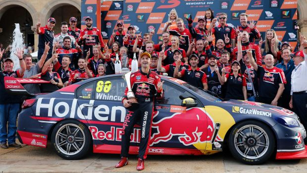 Dream team: Jamie Whincup celebrates winning race 26 and a record seventh Supercars championship.