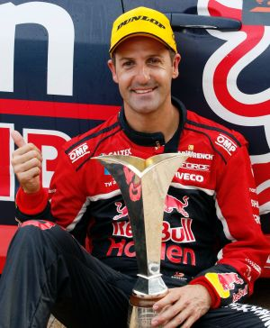 Race ace: Jamie Whincup with the Supercars Championship trophy, after winning the Newcastle 500.