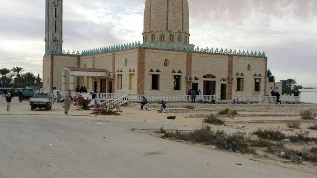 People gather at al-Rawdah Mosque in Bir al-Abd northern Sinai, Egypt a day after attackers killed hundreds of ...