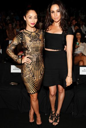 Cara Santana, left, and Meghan Markle attend the Herve Leger collection on Saturday, Sept. 7, 2013, during Mercedes-Benz ...