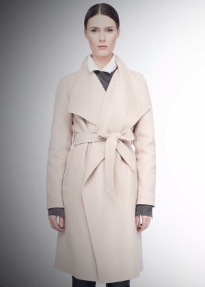 A coat by LINE the Label similar to that worn by Meghan Markle to announce her engagement to Prince Harry on Monday.