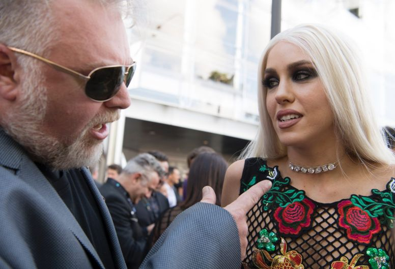 KIIS 1065's Kyle Sandilands points to the diamond he'll propose to Imogen Anthony with on the red carpet at the ARIAs.