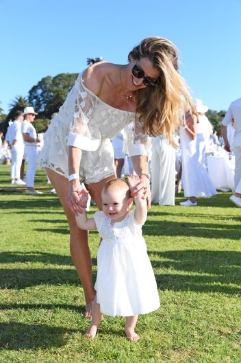 Laura Csortan and her daughter Layla Rose, one, at Diner en Blanc in Sydney's Centennial Park on Saturday, November 25, 2017.