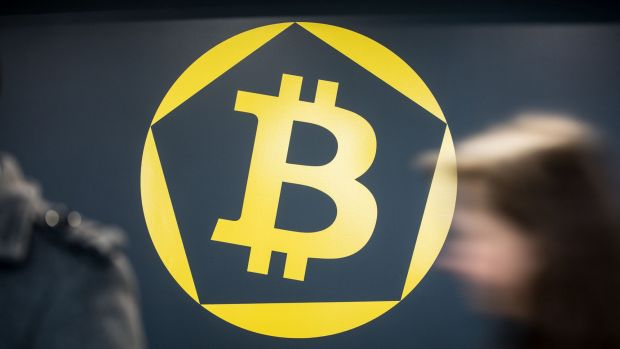 The Bitcoin symbol  at the offices of La Maison du Bitcoin bank in Paris.