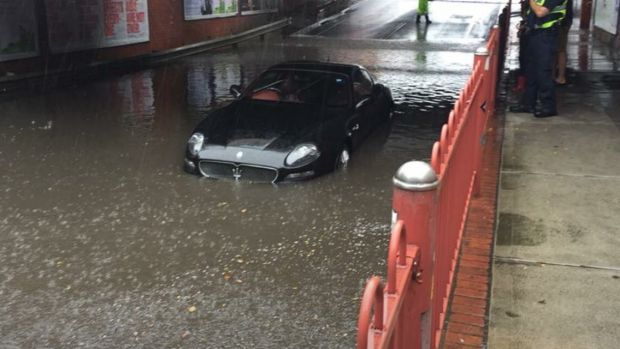 A Maserati stricken in floodwater on Victoria Street, Seddon.