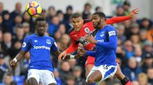 Huddersfield Town's Collin Quaner, center, in action with Everton's Idrissa Gueye, left, and Cuco Martina during the ...