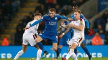 Leicester City's Jamie Vardy, centre, battles for the ball with Burnley's Scott Arfield and Jeff Hendrick during the ...