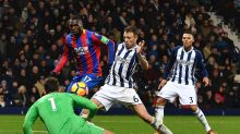 West Bromwich Albion's Jonny Evans, centre, and Crystal Palace's Christian Benteke battle for the ball during the ...