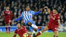 Brighton & Hove Albion's Jose Izquierdo, center, in action with Liverpool's Trent Alexander-Arnold during the English ...