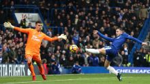 Chelsea's Eden Hazard, right, has a shot on goal during the English Premier League soccer match between Chelsea and ...