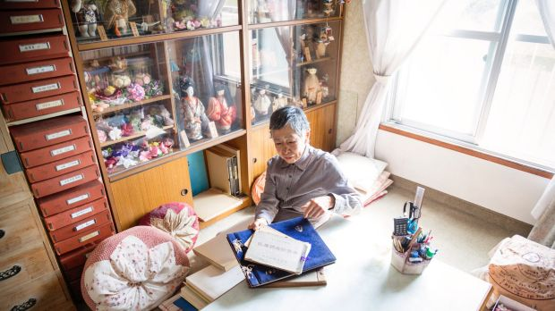 Chieko Ito puts away photo albums in her apartment. She has made sure her worldly affairs are entirely organised in the ...