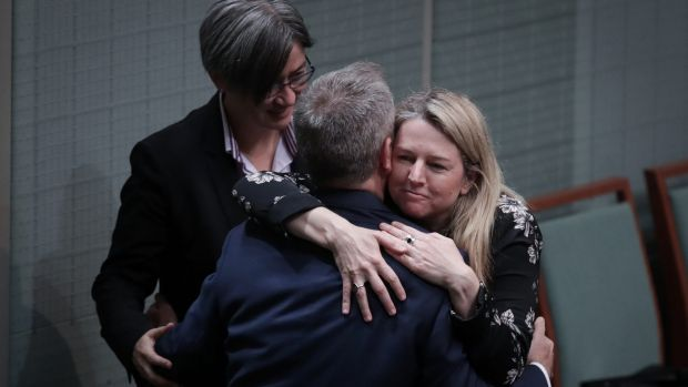 Opposition Leader Bill Shorten embraces Leader of the Opposition in the Senate Penny Wong and Senator Louise Pratt after ...