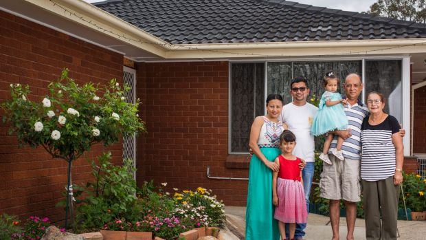 Three generations of the Chhetri family in their home in Marayong in Sydney, with the five adults paying the mortgage.  ...