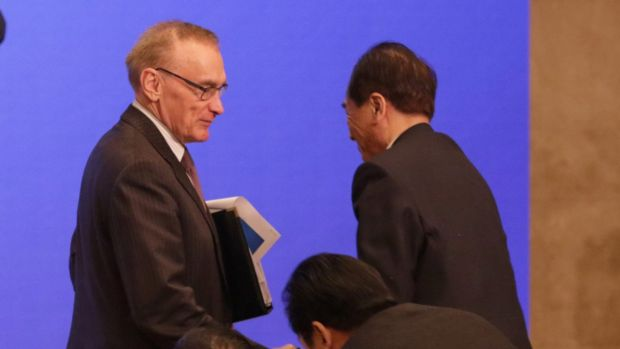 Former foreign minister Bob Carr is greeted by Cai Mingzhao, the president of China's Xinhua News Agency, after ...