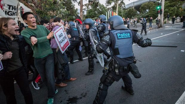 Riot police clash with protesters.