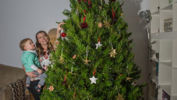 Sandra chose her real tree 'by placing a big pink ribbon on it' at Santa's Shaped Christmas Tree Farm at Sutton.