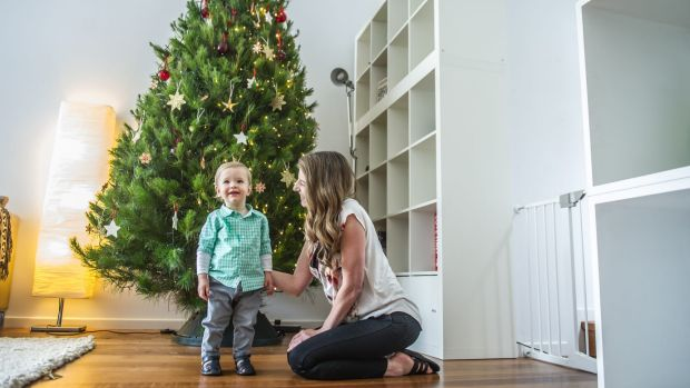 Sandra Feletti with 14-month-old son Marco Reed. It's just not Christmas for Sandra unless she has a real tree.