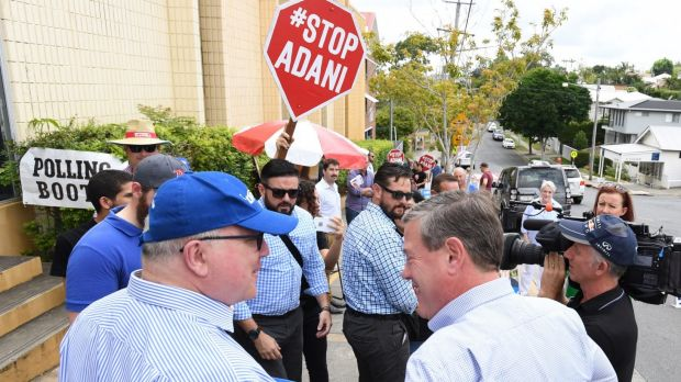 Attorney-General Georg Brandis and Queensland LNP leader Tim Nicholls with anti-Adani coal mine protesters during the ...