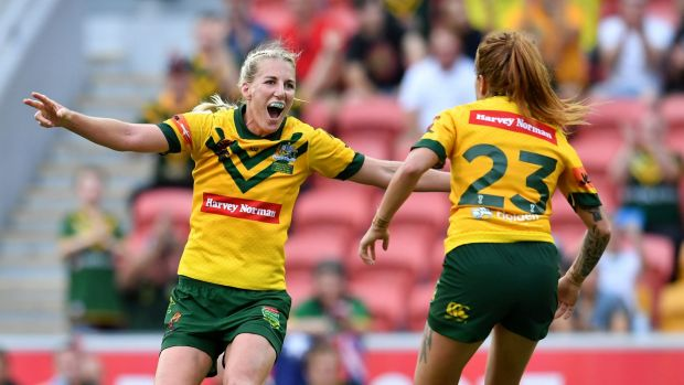 Giant leap for women's rugby league: Ali Brigginshaw, left, and Caitlin Moran celebrate after winning the World Cup last ...