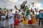 In this Thursday Nov. 30, 2017 photo, people take part in an annual parade celebrating the birth anniversary of Prophet ...
