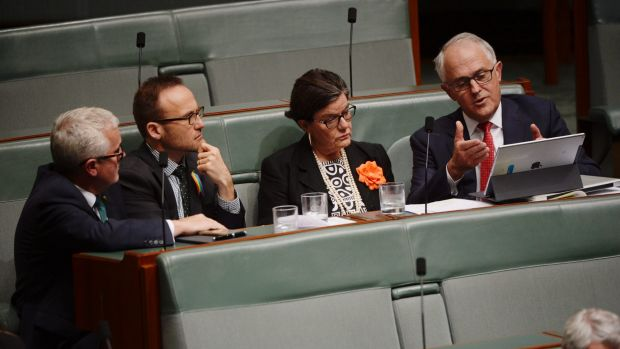 Prime Minister Malcolm Turnbull talks to the crossbenchers Andrew Wilkie, Adam Bandt and Cathy McGowan in the House of ...