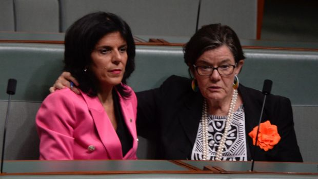 Liberal MP Julia Banks, who is one of the nine MPs the opposition wants referred to the High Court, sits with ...