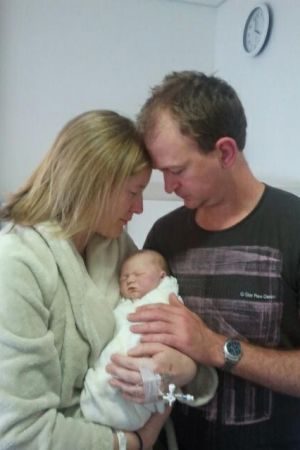 Heidi and Ned Mules with their stillborn daughter, Sophie.