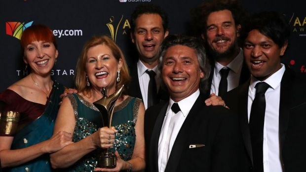 Angie Fielder (left) with the Lion filmmakers and Brierley family after winning best film at the AACTA Awards.