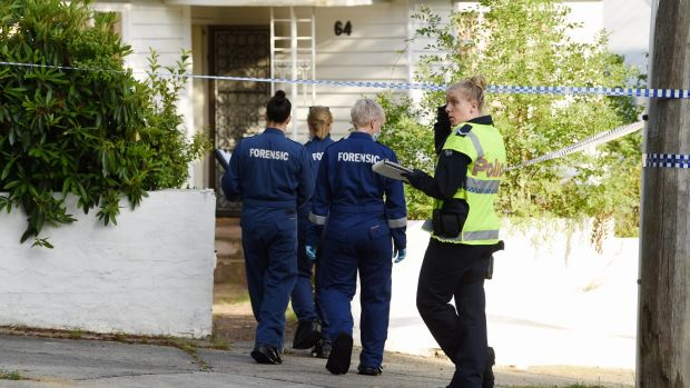 Police, forensic and homicide squad officers at the Mitcham home where a man's body was found on Thursday morning.
