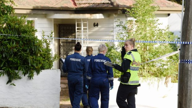Police, forensic and homicide officers at a home in Cochrane Street in Mitcham, where police discovered a man's body ...