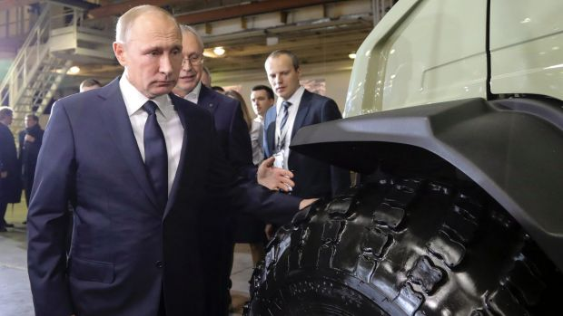 Russian President Vladimir Putin announced his intention to seek re-election for a record term at the GAZ factory in ...