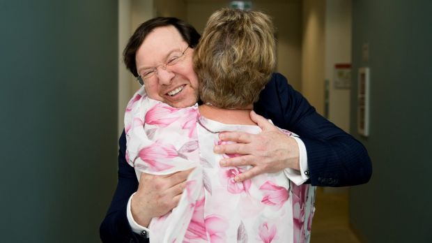 Professor John Rasko gets a hug from Eunice Lee, after her son, Mark, successfully completed a gene therapy trial for ...