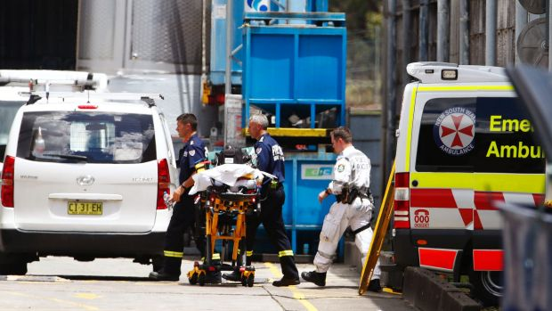 Emergency workers at the scene after three men became trapped in a tank in Auburn on Thursday.