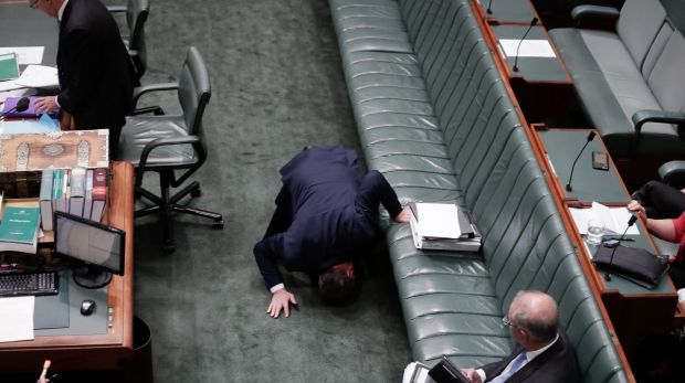 Deputy Prime Minister Barnaby Joyce looks for something under the frontbench as he arrives for question time on Thursday.