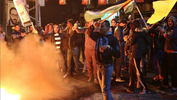 Palestinian protestors burn tires during a protest in the main square of Gaza City on Wednesday.