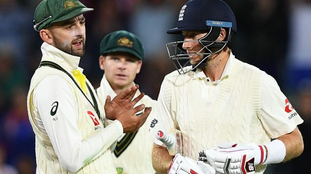 Nathan Lyon has words with England captain Joe Root during the tense second Test at the Adelaide Oval.