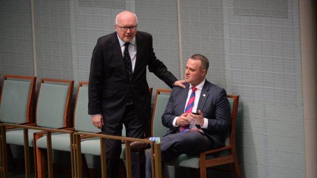 Attorney-General George Brandis watches the same-sex marriage debate with Liberal MPtim Wilson on Thursday.