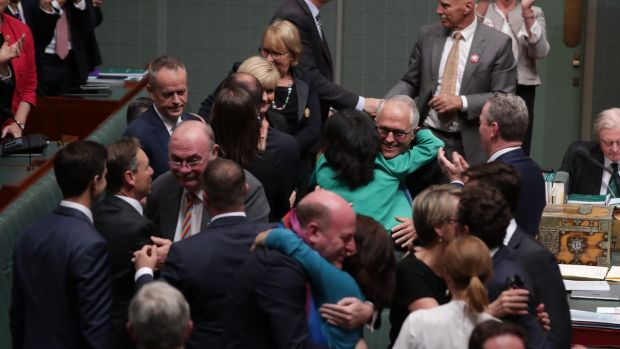 The scenes from the House of Representatives when the laws passed on Thursday.