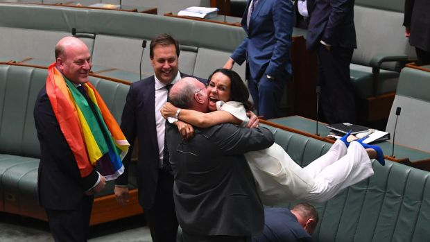 Liberal MP Warren Entsch lifts Labor MP Linda Burney into the air after the same-sex marriage vote in the House of ...