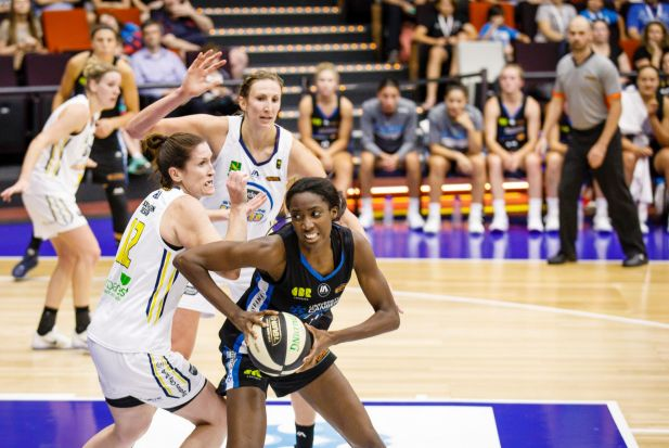 Capitals' forward Ezi Magbegor secures the ball before scoring a two-pointer.