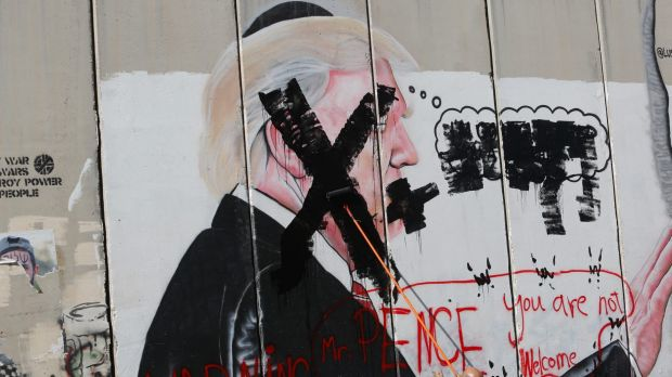 A defaced poster of the US President Donald Trump during a protest in Bethlehem, West Bank.