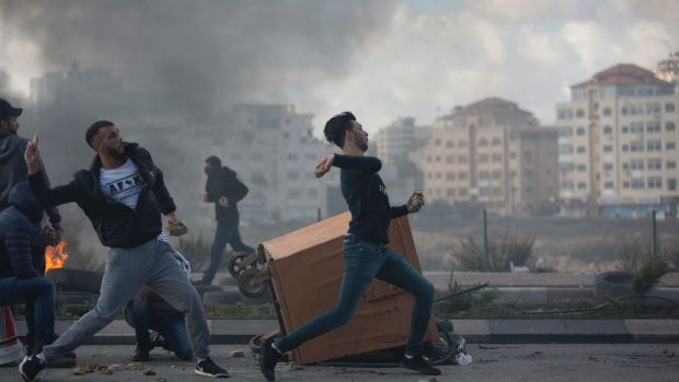 Palestinian protesters clash with Israeli troops following protests against U.S. President Donald Trump's decision to ...