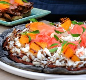 Rice-based Japanese pizza bases blackened with squid ink at Sash.