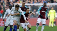 West Ham United's Mark Noble, center, is challenged by Chelsea's Marcos Alonso during the English Premier League soccer ...