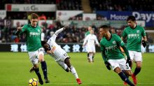 Swansea City's Nathan Dyer, second left, and West Bromwich Albion's Sam Field, left, battle for the ball during their ...