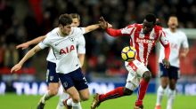 Tottenham Hotspur's Ben Davies left, and Stoke City's Mame Biram Diouf battle for the ball du,ring their English Premier ...